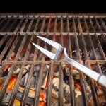 Hot BBQ Grill, Fork, Glowing Coals. Background with space for text or image.