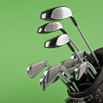 steel golf clubs on chroma green background